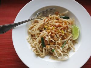 Phad Thai is commonly eaten with a fork and spoon.