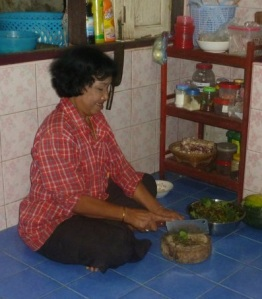 My mae preparing dinner in our home in Ban Heep.